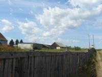 Imobil situat in Arpasu de Jos, teren 2574 mp, construcţii diverse