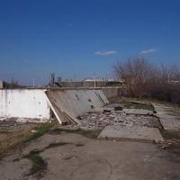 Amplasament industrial, situat în loc. Turnu Măgurele, str. Portului, jud. Teleorman - compus din teren intravilan în suprafață de 7.379 mp și construcții